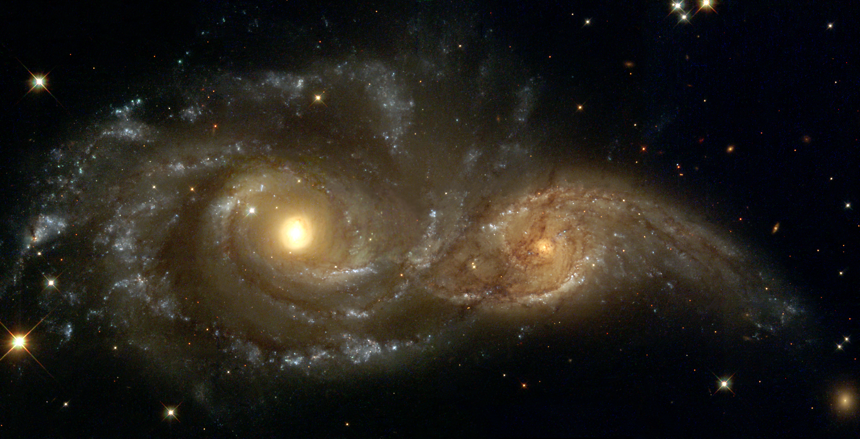 the importance and benefits of space exploration pr herald a grazing encounter between two spiral galaxies